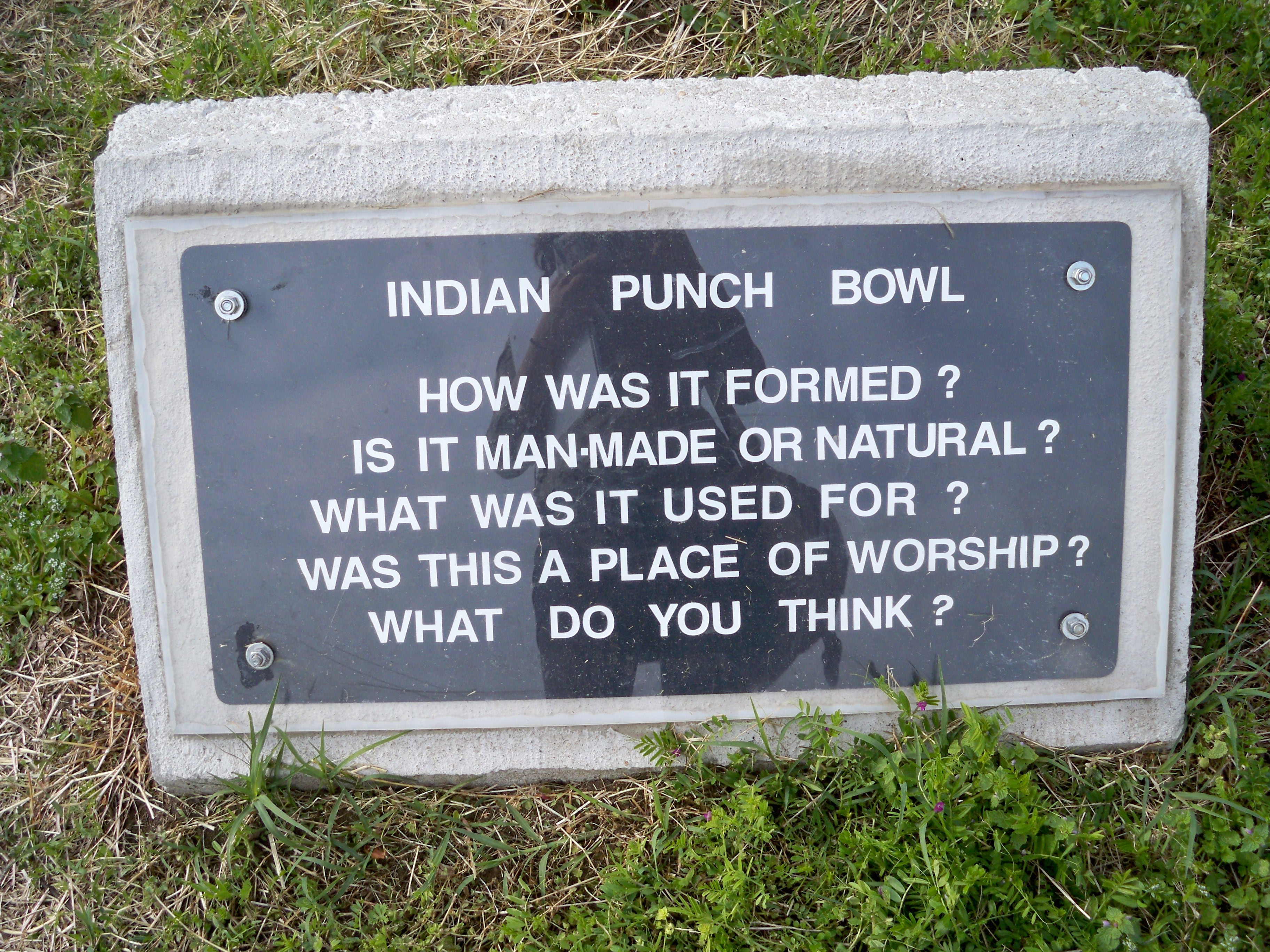 A sign placed next to the Indian Punch Bowl that asks visitors to consider its origins and uses.Photo Credit: Lara Belfield