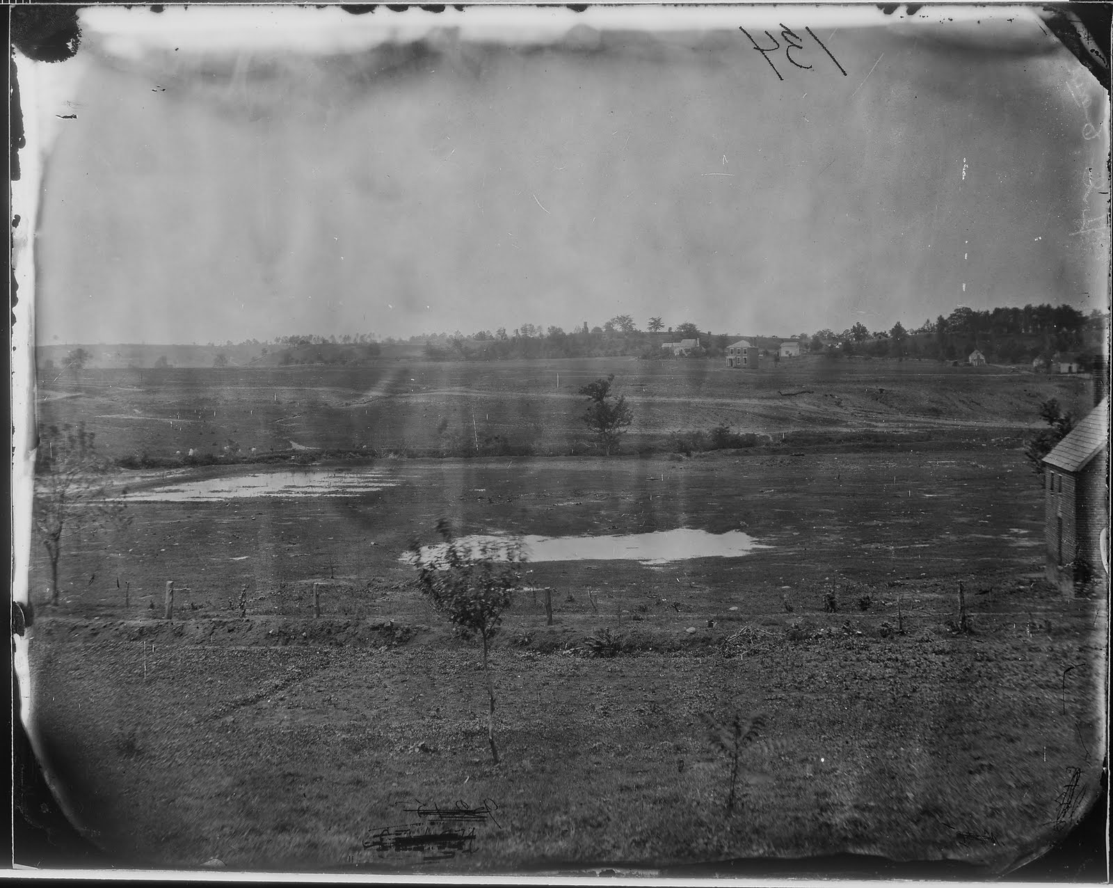 The Canal Ditch during the Civil War can be seen in the middle ground as a darker spot on the plain.Photo credit: John Cummings, http://spotsylvaniacw.blogspot.com/2011/07/gross-what-are-they-doing-latrine-at.html